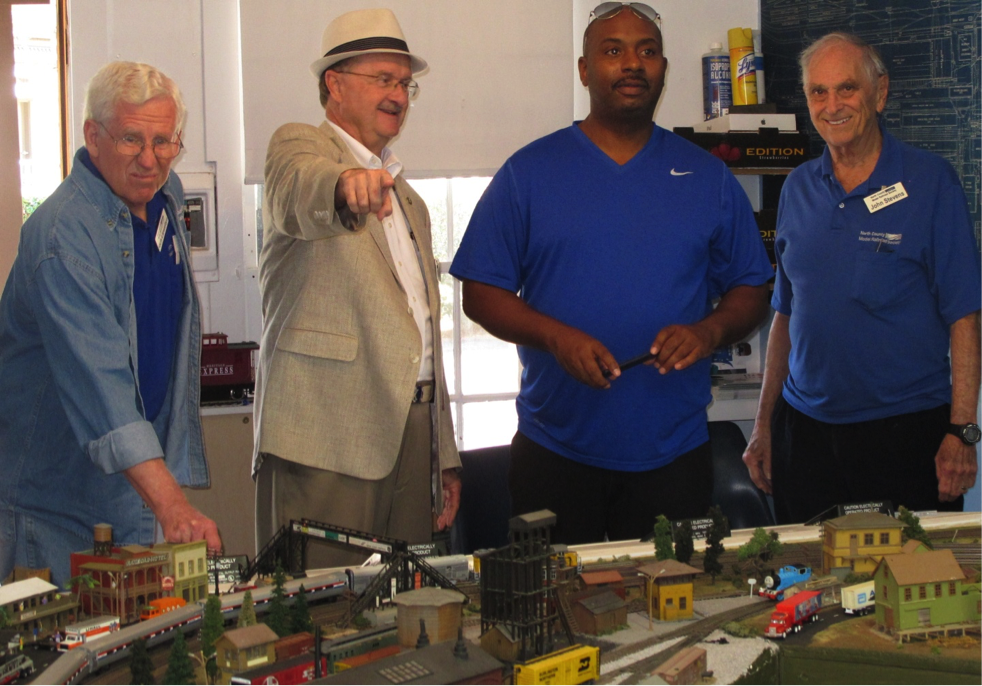 Oceanside Mayor Jim Wood (left) and NCTD CEO Matt Tucker (right) inspect HO model of NCTD Coaster Train at NCMRS.