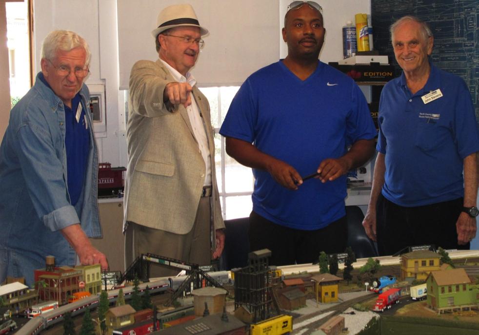 Oceanside Mayor Jim Wood (left) and NCTD CEO Matt Tucker (right) inspect HO model of NCTD Coaster Train at NCMRS.